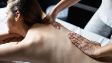 young-beautiful-woman-lying-on-massage-table-and-9546NRM-370x208.jpg