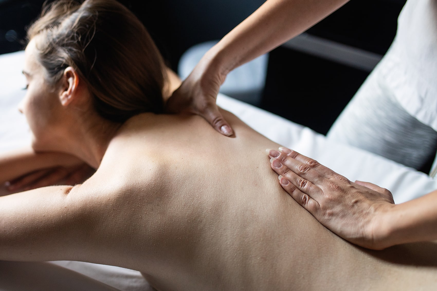 young-beautiful-woman-lying-on-massage-table-and-9546NRM.jpg